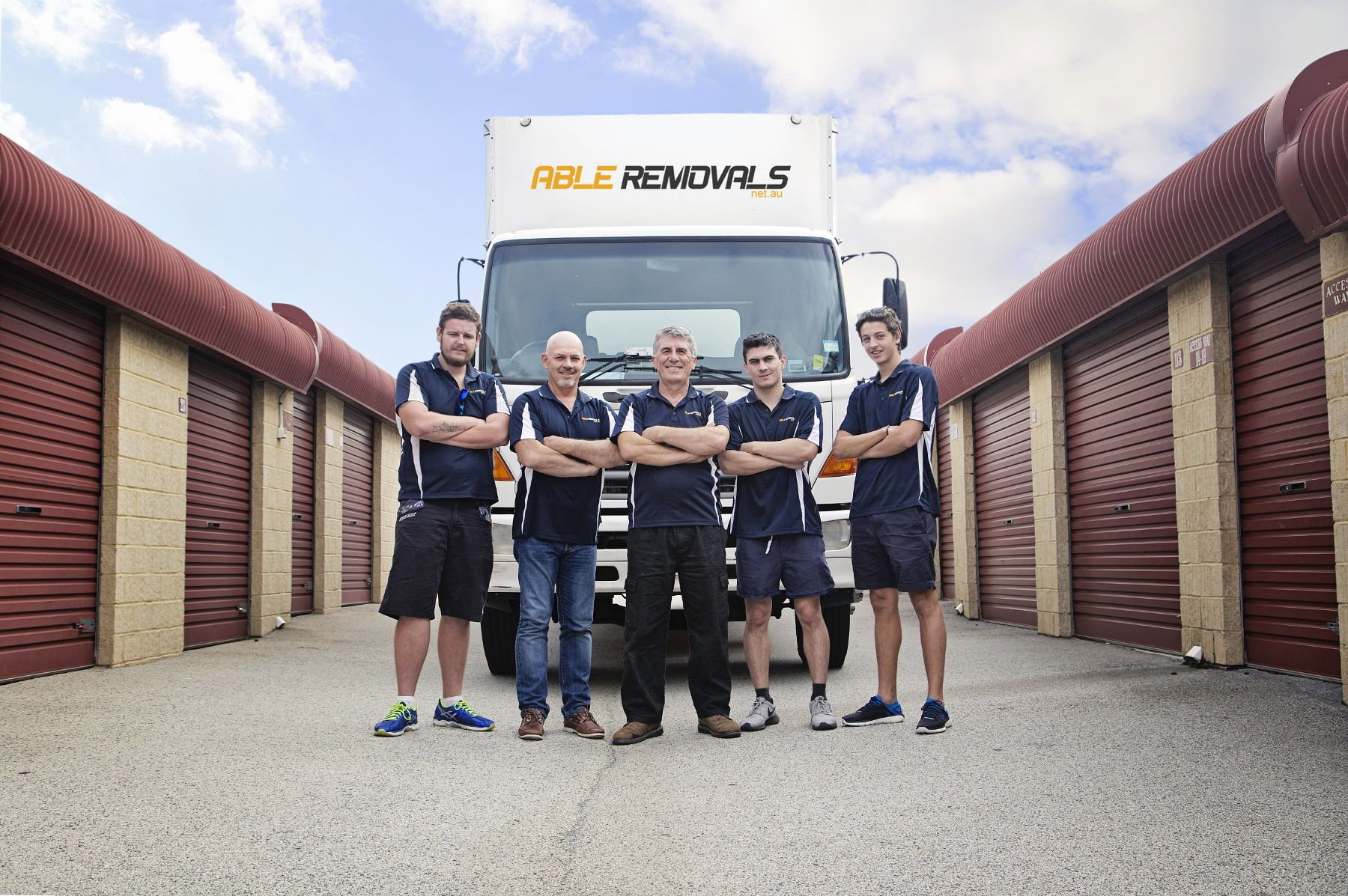 The team in front of moving van