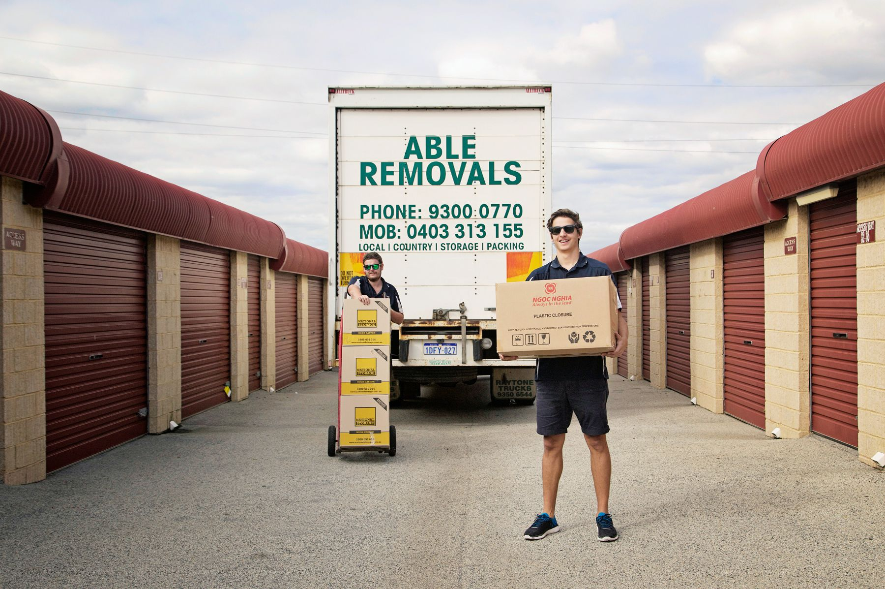 Staff holding moving boxes